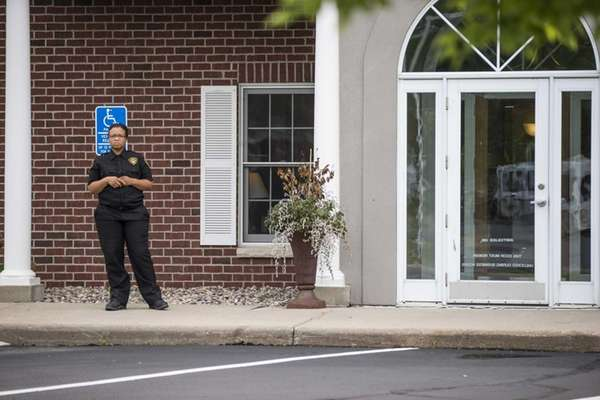 A security guard stands outside Dr. Walter Palmer's