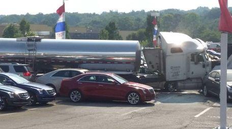A HeraldA milk tanker truck rests among new