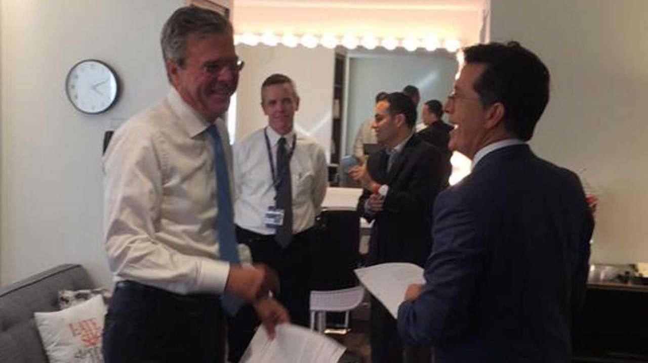 Jeb Bush, left, and Stephen Colbert chat on