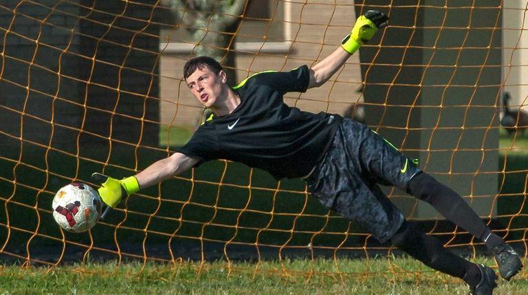 Hicksville goalie Connor McPartland makes a save during