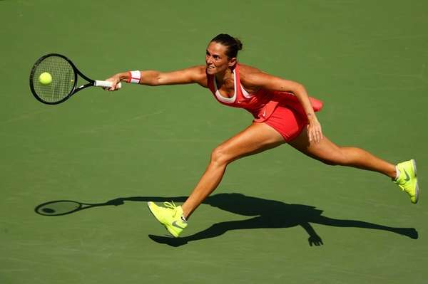 Roberta Vinci of Italy returns a shot to
