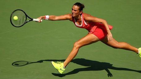 Roberta Vinci of Italy returns a shot to