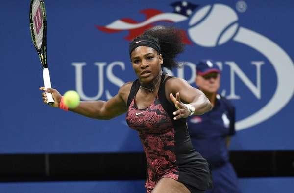 Serena Williams returns to Venus Williams during the