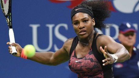 Serena Williams returns to Venus Williams during the