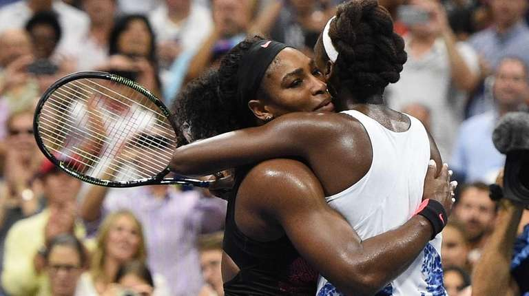 Serena Williams embraces Venus Williams after she wins