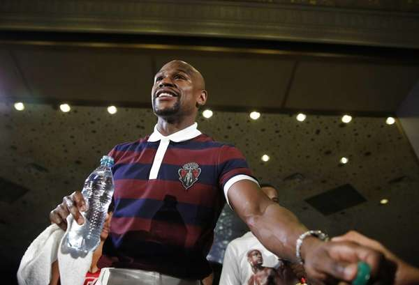 Floyd Mayweather Jr. stands on stage during a