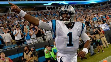 Cam Newton #1 of the Carolina Panthers salutes