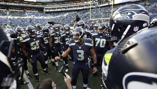 Seattle Seahawks quarterback Russell Wilson (3) leads his