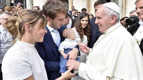 Pope Francis meets a young couple with their