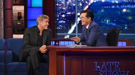 George Clooney with host Stephen Colbert on the