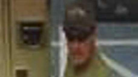A surveillance image shows a man who stole