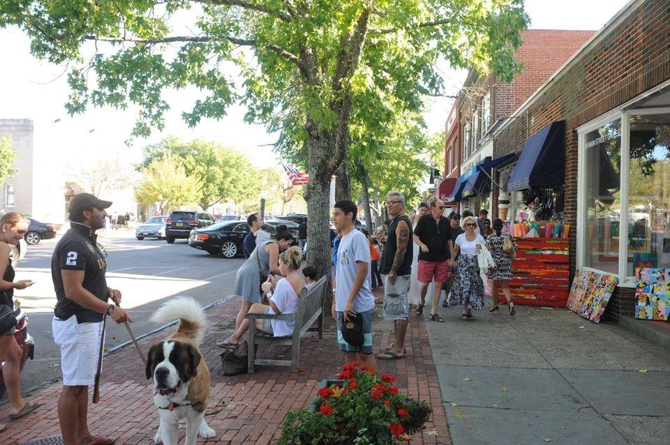 People walk along Main Street in Southampton on