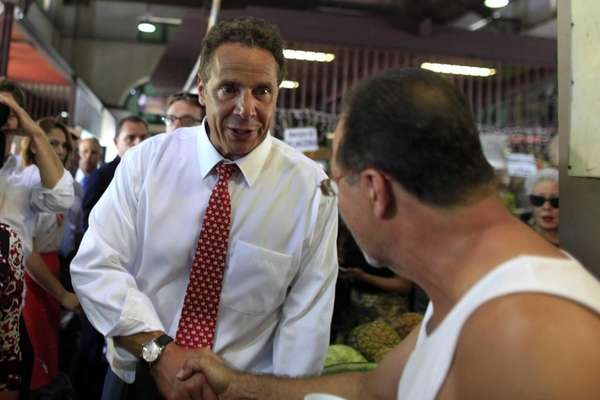 New York Gov. Andrew Cuomo greets a bystander