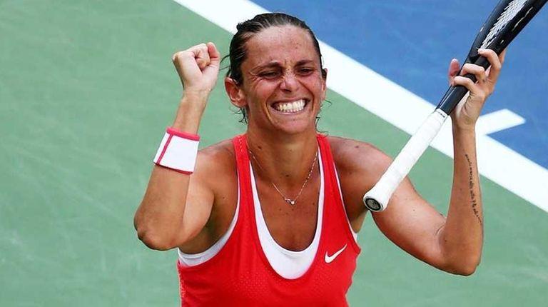Roberta Vinci celebrates after defeating Kristina Mladenovic in
