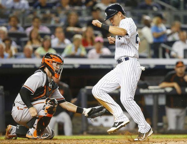 Jacoby Ellsbury of the New York Yankees scores