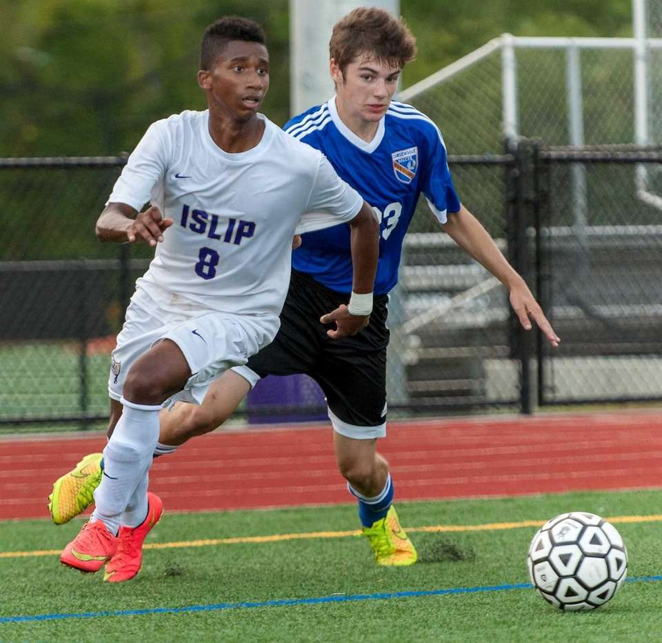 Islip's Junger Herazo, left, and Comsewogue's Liam Micheline