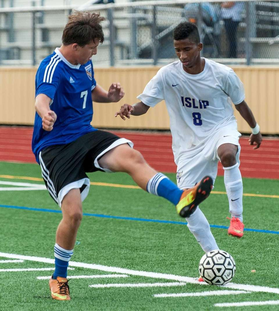 Islip's Junger Herazo, right, and Comsewogue's Trevor Kennedy
