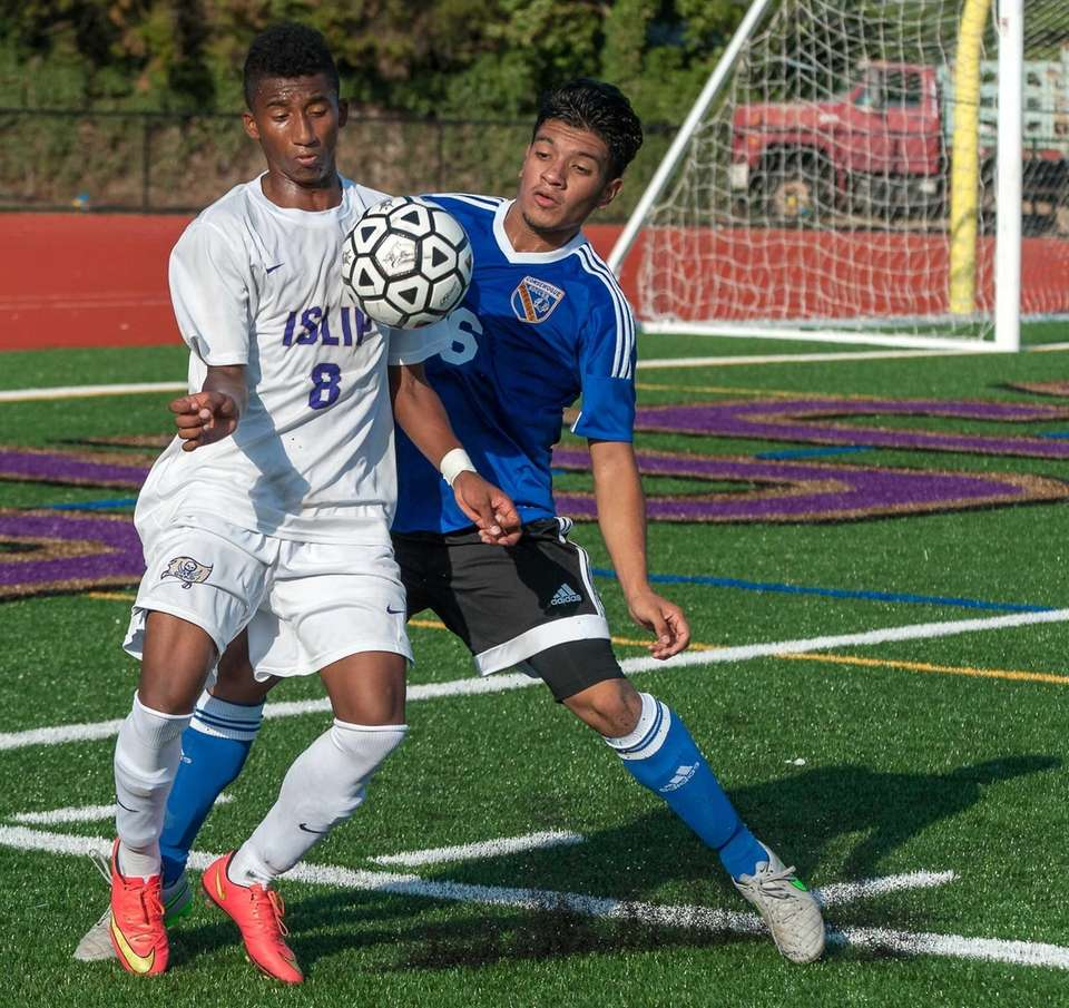 Islip's Junger Herazo, left, and Comsewogue's Henry Garcia