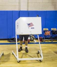 Bob Goodale, from Mattituck, casts his vote for