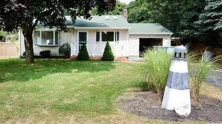 This starter home in Hampton Bays is listed