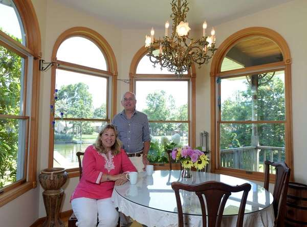 Sellers Nina and Sullivan Gallo pose in the
