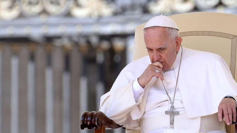 Pope Francis gestures as he attends the weekly