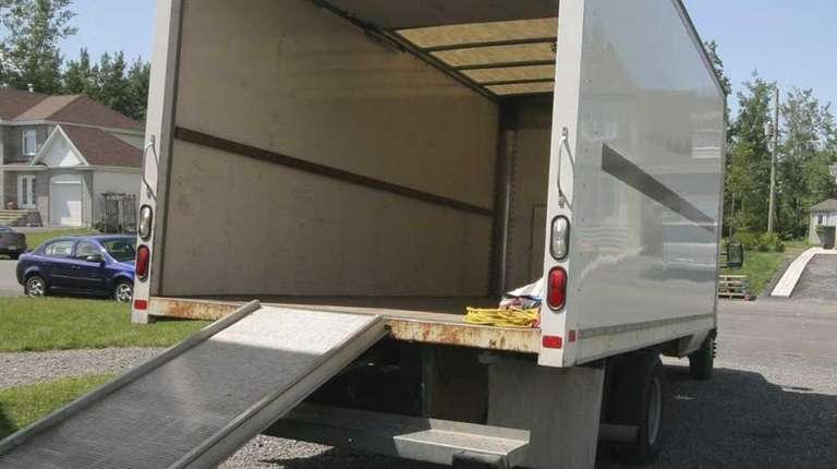 A moving van being loaded.