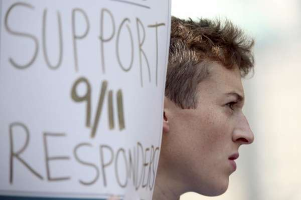 An activist holds a sign in support of