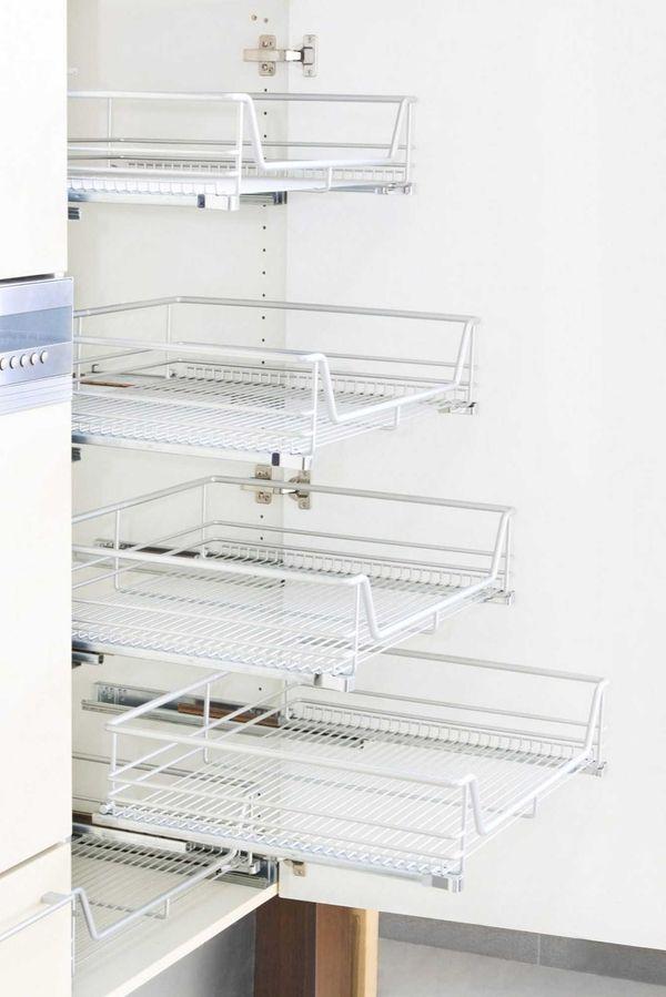 Installing wire shelving in kitchen cabinets creates plenty