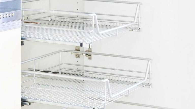 Installing wire shelving in kitchen cabinets creates plenty