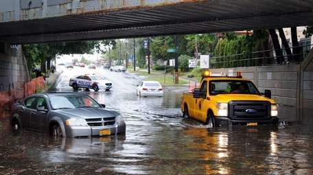 Two cars are seen stalled in the water