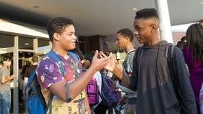 Students greet each other outside the Ross Center