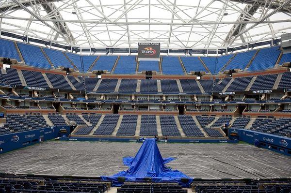 A tarp covers the court on Arthur Ashe