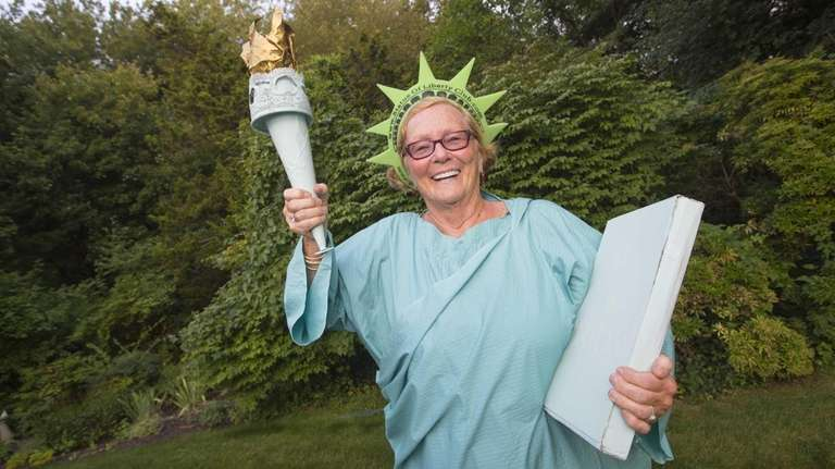 Nancy Sherman poses in her Statue of Liberty