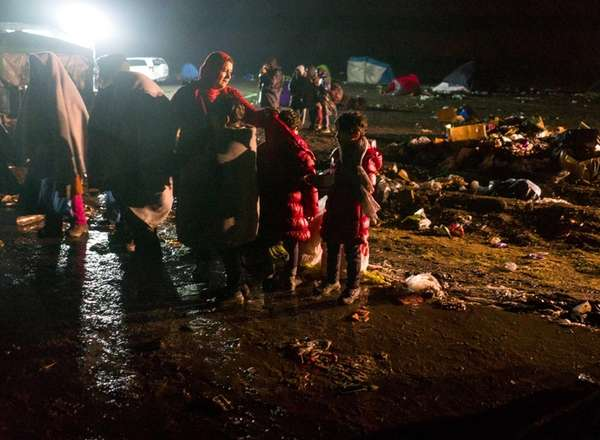 Refugees deal with mud, broken tents and disarray