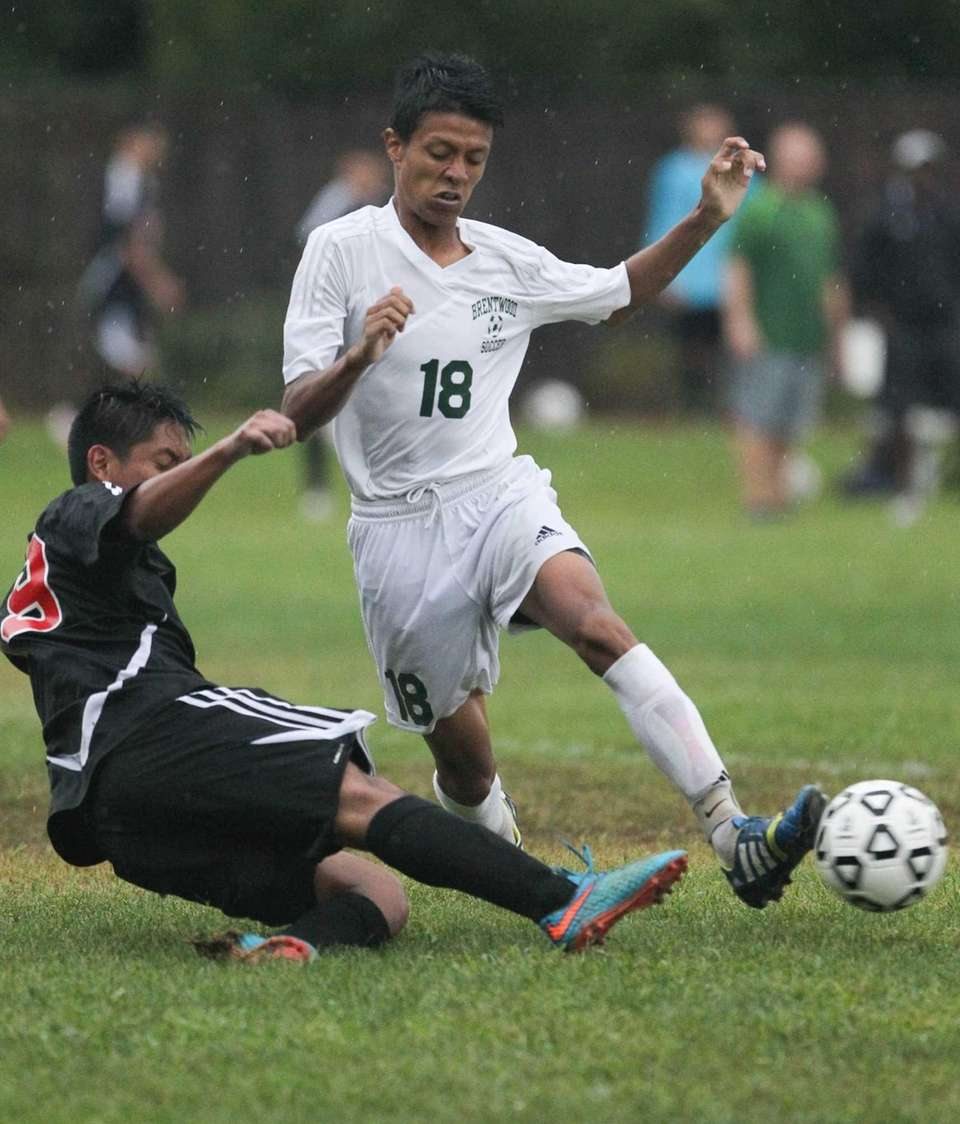 Brentwood's Alexis Alvarez attempts to get around Patchogue-Medford's