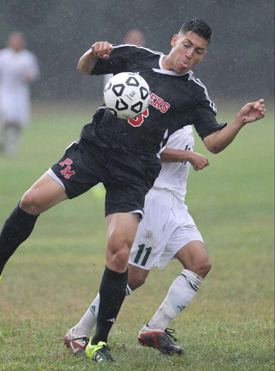 Patchogue-Medford's Edras Granados plays the ball away from