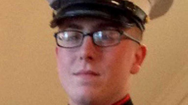 Marine Cpl. Keith Miller graduated from East Islip