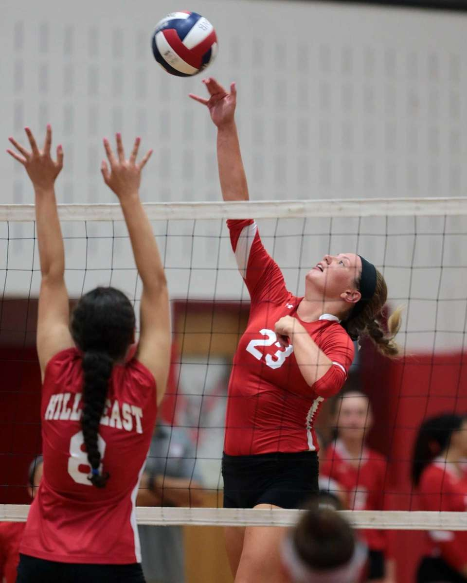 Connetquot's Katie Von Kampen hits at the net