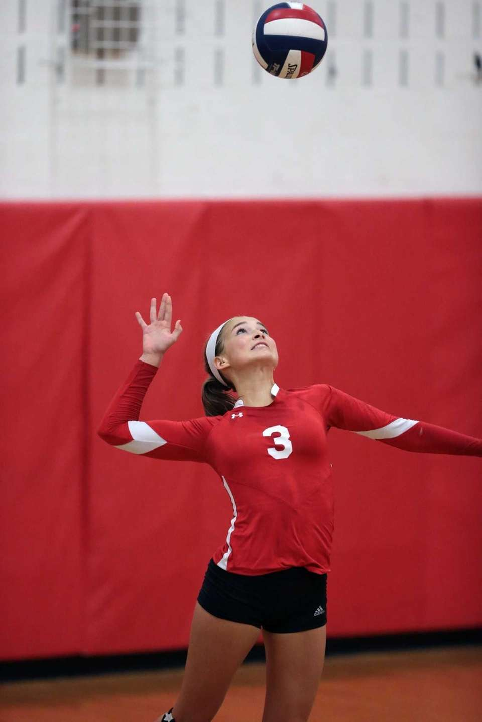 Connetquot's Taylor Cole serves the ball during a