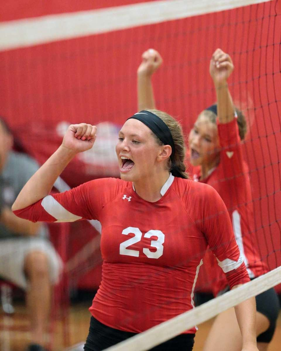 Connetquot middle hitter Katie Von Kampen celebrates with