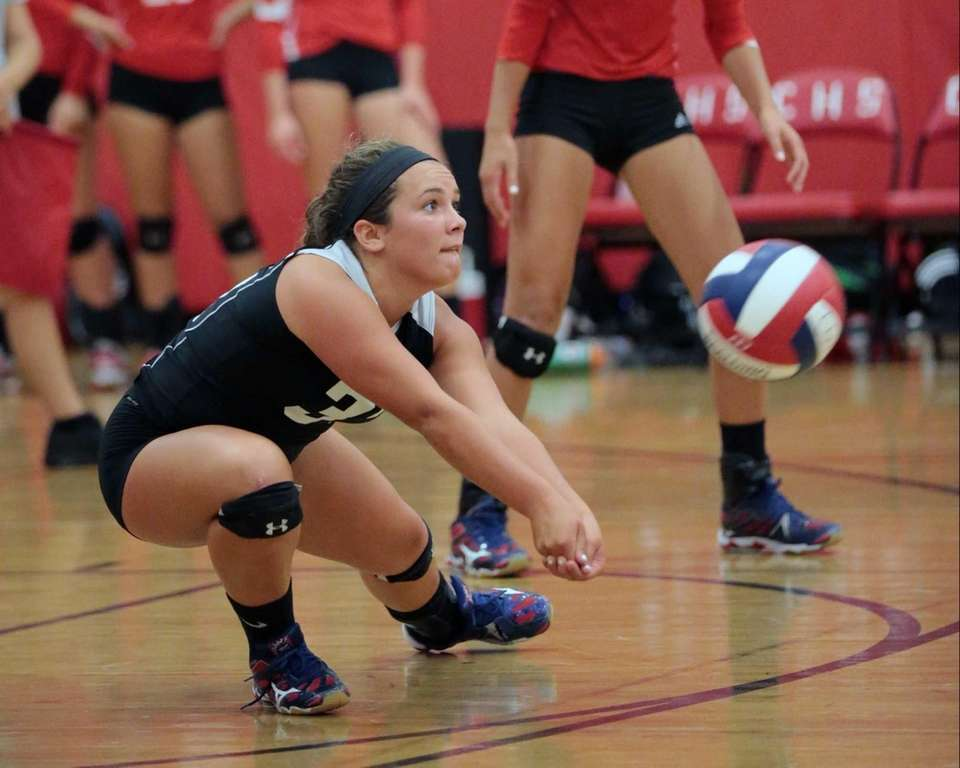 Connetquot libero Daniella Balsano digs up the ball