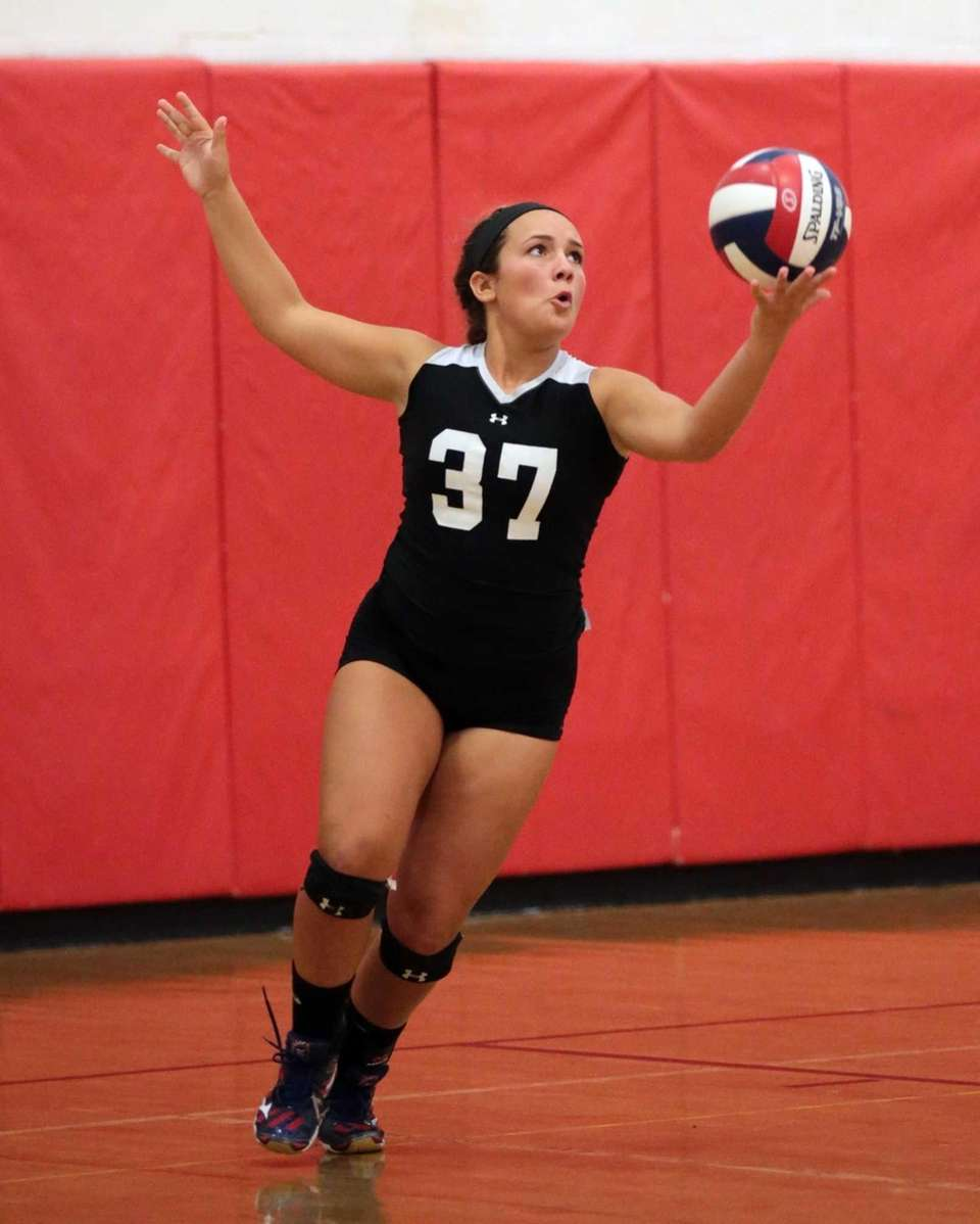 Connetquot libero Daniella Balsano serves the ball during