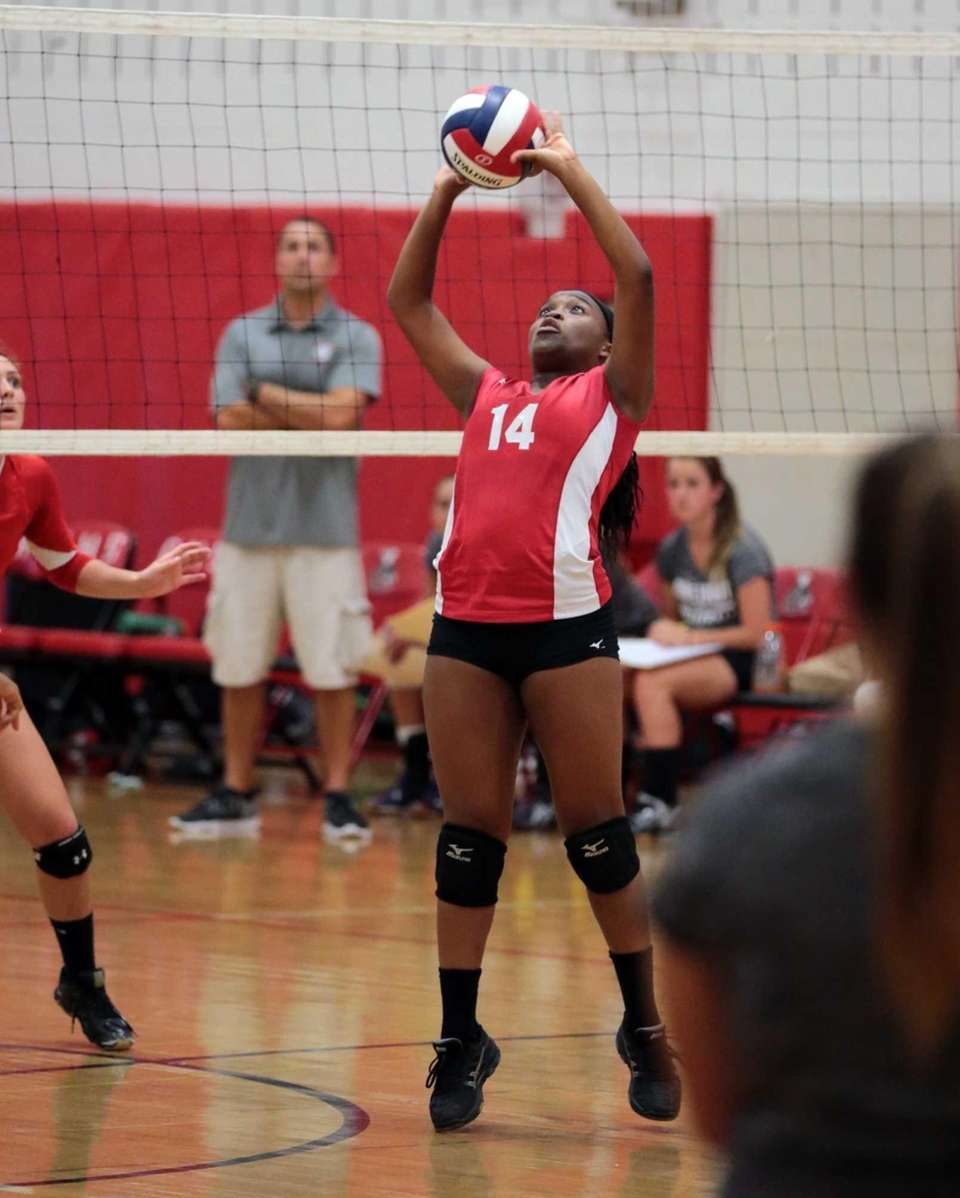 Half Hollow Hills East's Darleenn Altema-Bouzi sets the