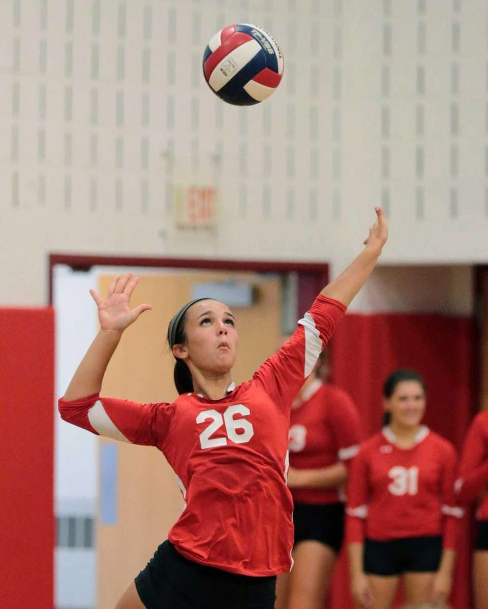 Connetquot's Nicole Migliozzi serves during a girls volleyball
