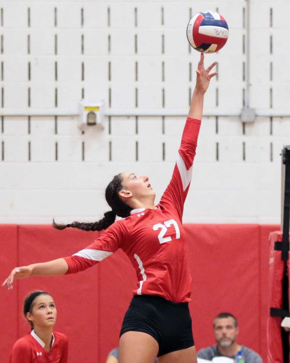 Connetquot outside hitter Cassandra Patsos tips the ball