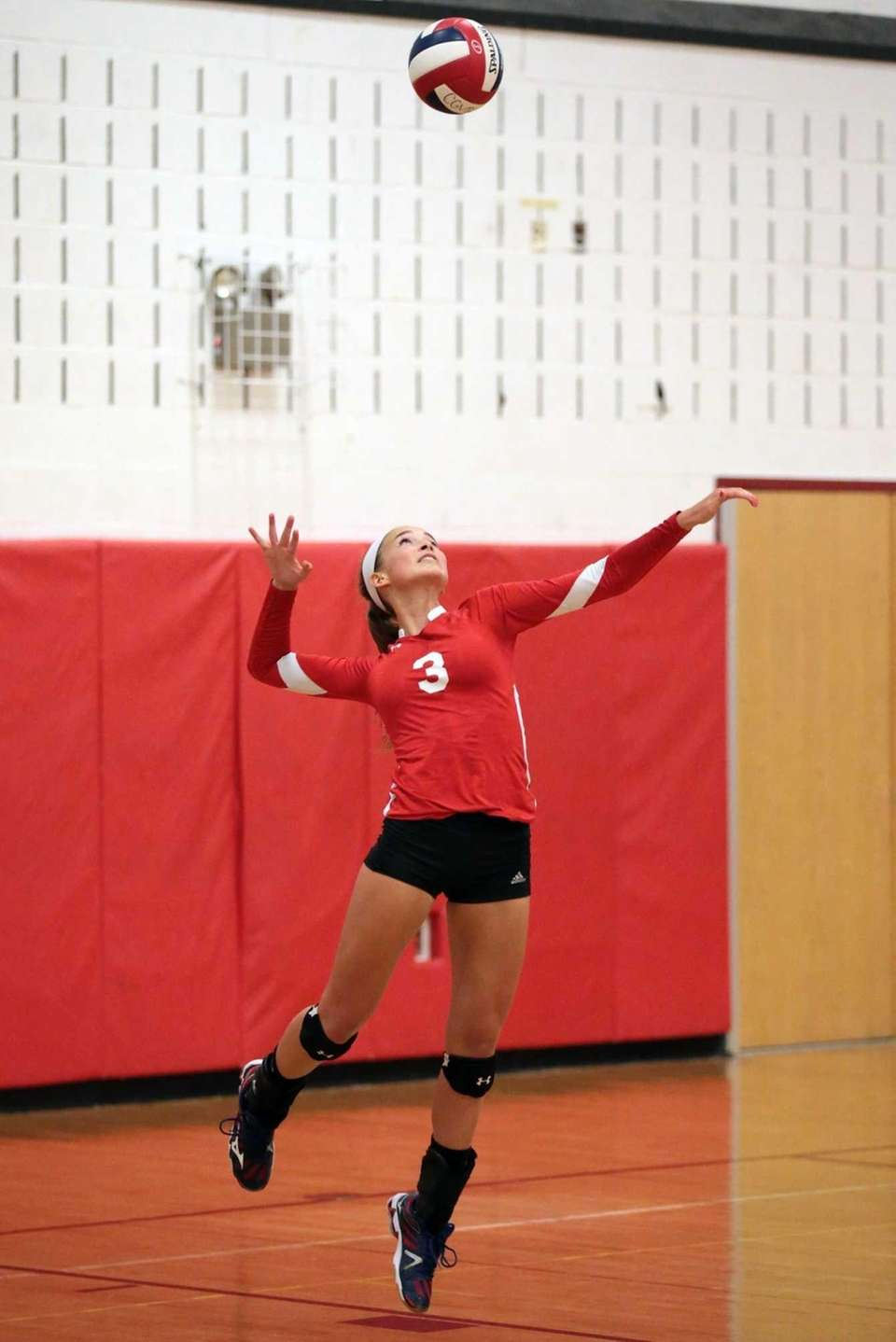 Connetquot's Taylor Cole serves during a girls volleyball