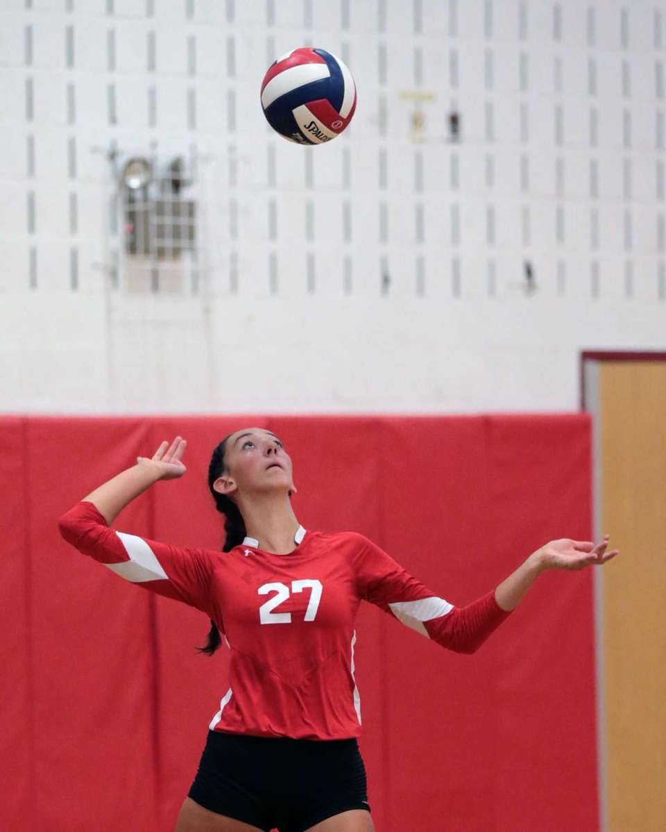 Connetquot's Cassandra Patsos serves the ball during a