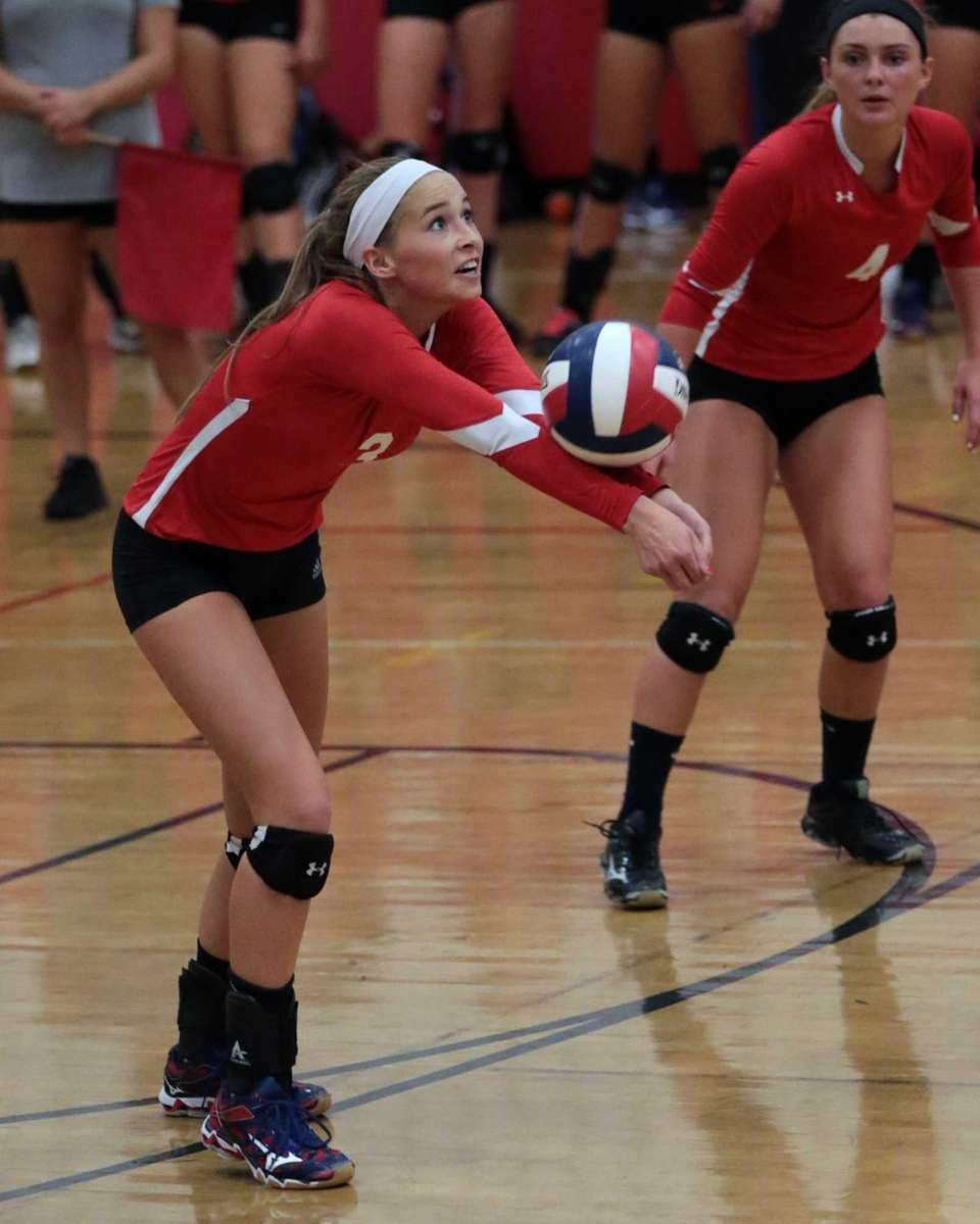 Taylor Cole of Connetquot passes the ball during