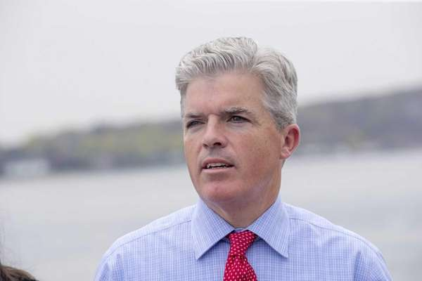 Suffolk County Executive Steve Bellone attends a news